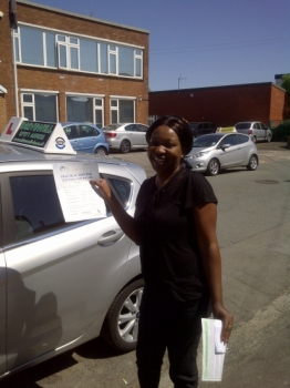 Proudly holding her Pass Certificate.   great drive with few faults.  MAY 2012...