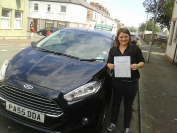 Gwennan Hardy delighted, holding her Pass Certificate after passing her test first time today.  A super drive with only a few driver faults with the added pressure of a Trainee Examiner observing in the back.  It is never easy combining Uni work with lessons, but you did well juggling timetables and learning. Congratulations and well done again.  G...
